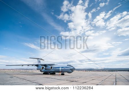 Russia - April, 2015: An old Soviet cargo plane IL-76 is a multi-purpose four-engine turbofan strategic airlifter parked at the airport.
