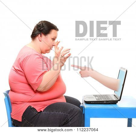 Overweight woman finding new diet online on her laptop. Picture with space for your text.
