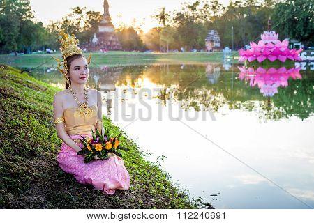 Thai lady with floating basket for Loi Krathong festival,Sukhothai