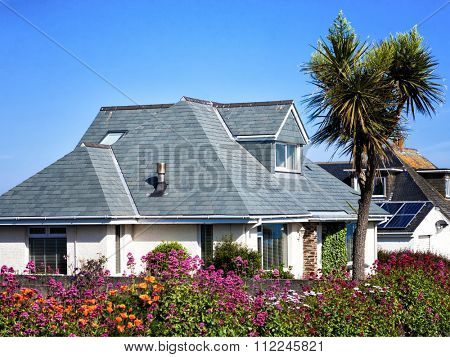 House with gardens in full bloom