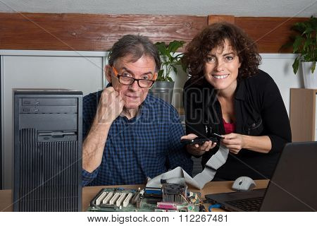 Computer Technician Repairing Pc Together Man And Woman