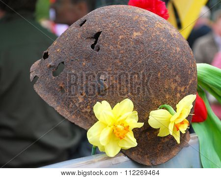 The Soldier's Helmet Punched By Bullets.