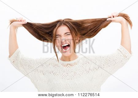 Desperate hysterical shouting young woman in black clothes over white background