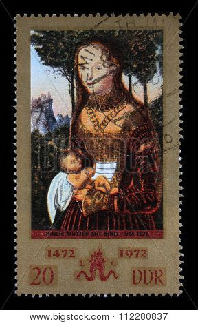 GDR-CIRCA 1972: A stamp printed in GDR from the Paintings issue shows Young mother with child (so called Penance of St. John Chrysostom) by Lucas Cranach the Elder, circa 1972.