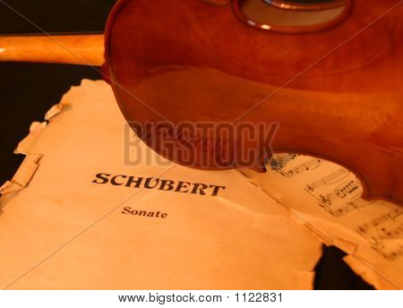a typical classic violin over some scores