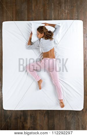 Top view photo of sleeping girl