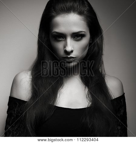 Expressive Portrait Of Brunette Woman With Mystical Look In Dark. Black And White Portrait