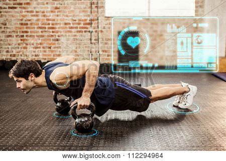 Man doing push ups with kettlebell against fitness interface
