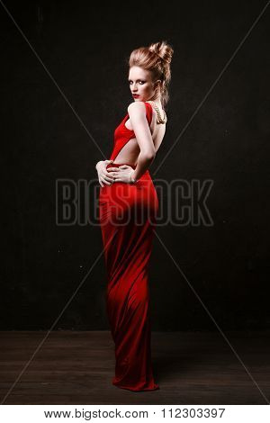 Studio Shoot Of Posing Woman In Long Red Dress. Retro Style.
