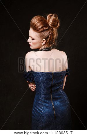 Studio Shoot Of Posing Woman In Sexy Blue Dress. Retro Style. Creative Makeup And Hairstyle.