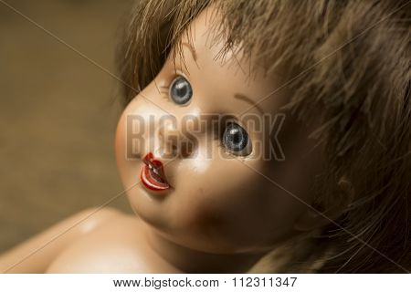 Face of an antique doll