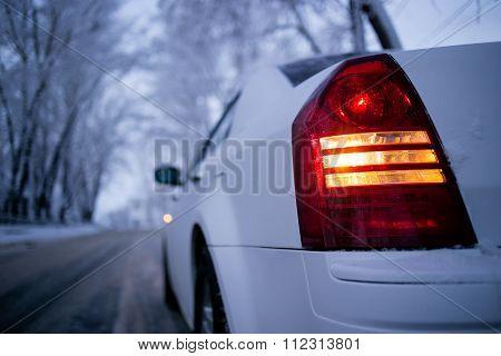Back light of white car upside-down view. Winter landscape bokeh