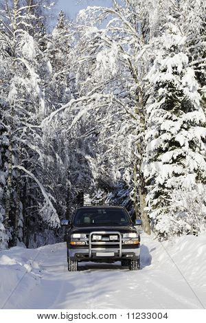 suv driving in snowy conditions