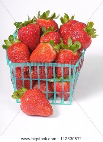 Punnet or basket of fresh strawberries on a white background