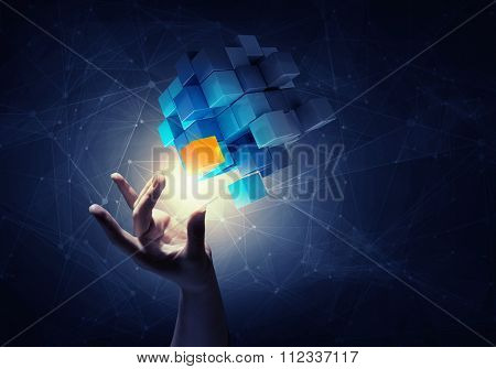 Businesswoman hand touch cube as symbol of problem solving