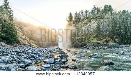 Scenic View Of Snoqualmie Falls With Golden Fog When Sunrise In Winter Season,washington,usa.