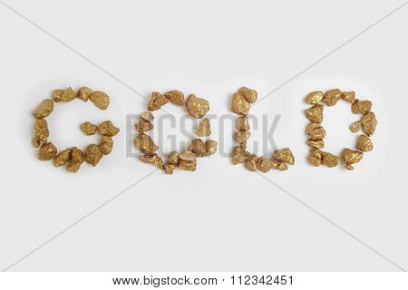 Gold Nuggets Text Background. Finance And Rates