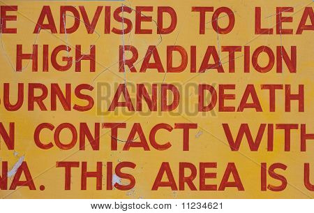 A portion of a sign warning of the dangers of radiation levels in the aera poster