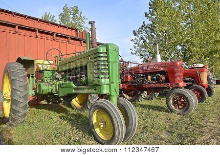 John Deere and Farmall tractors
