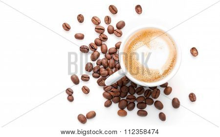 Small Cup Of Cappuccino With Coffee Beans