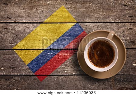 Colombia flag with coffee on table. top view poster