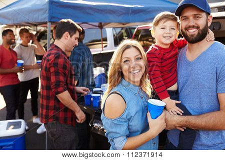 Portrait Of Family Group Tailgating In Stadium Car Park