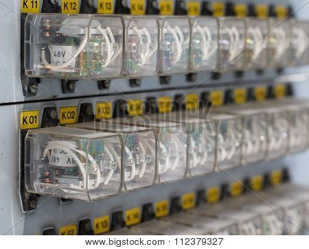 Row Of White Relay Actuators With Yellow Marks