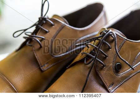 Close up of Groom dressy elegant shoes. (soft focus)