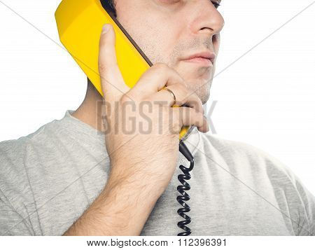 Caucasian Man Talking On A Landline Phone.