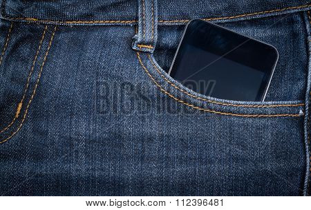 Black Smartphone In Your Pocket Jeans. Background.
