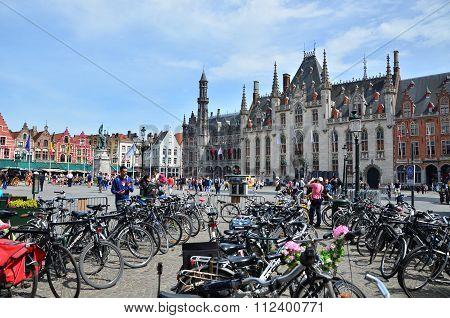 Bruges, Belgium - May 11, 2015: Tourist On Grote Markt Square In Bruges,