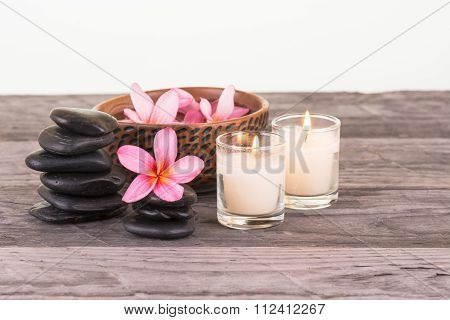 Plumeria Flowers, Black Stones And Candles