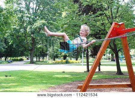 Little Girl On A Swing.