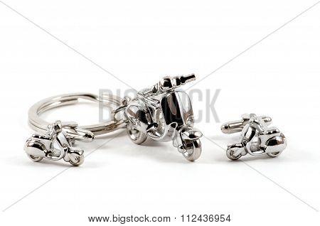 Isolated Motorbike Keychain And Cufflinks