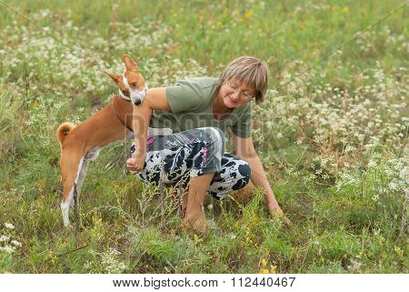Basenji dog bites master while playing outdoors