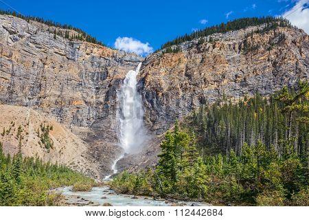 Yoho National Park. Autumn full-flowing waterfall Takakkaw. Rocky Mountains of Canada