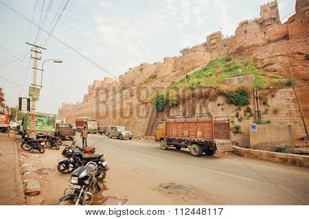 Truck Driving On Dirt Road Near Historical Jaisalmer Fort Built In 1156 Ad