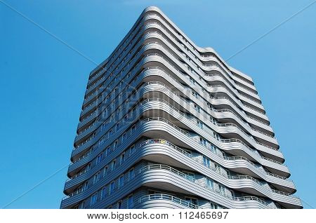 Modern high-rise building with rounded corners