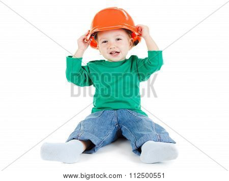 Little Child Plays With Orange Construction Protective Helmet  On White Background.