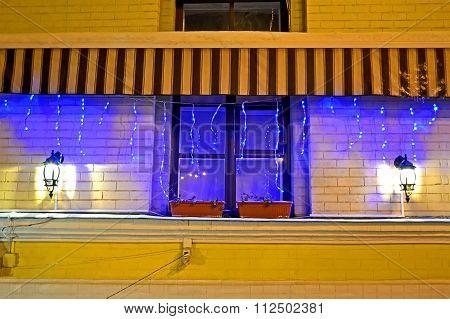 garland lamp light with illumination on window, holiday diversity