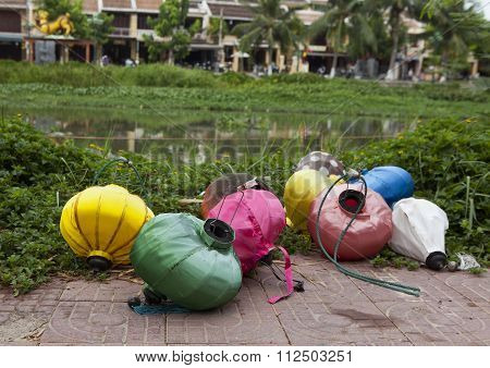 Damaged lanterns thrown on the river side in Hoi An acient town, Vietnam.