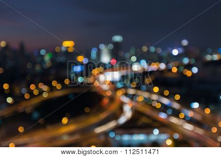 Blurred bokeh light city highway road interchanged