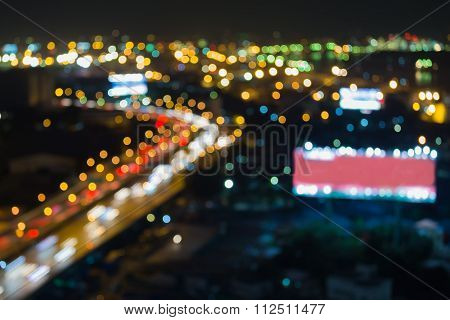Abstract blurred bokeh lights road curved at night