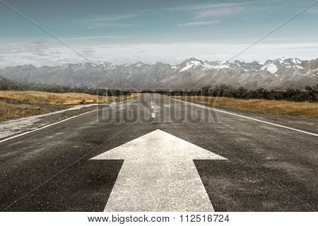 Natural landscape and asphalt road with forward arrow sign