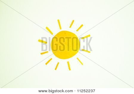 A Sun Drawing On A White Wall
