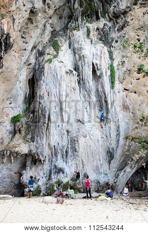 People Climbing Up A Steep Limestone Cliffs