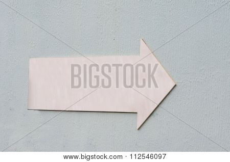 Pink Elongated Arrow On Rough Bluish Background For Graphic
