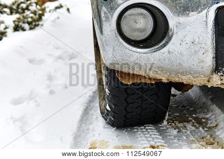 Truck Tire and Fender in Snow