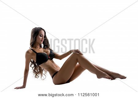 Image of busty slim model posing in black lingerie