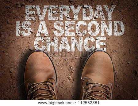 Top View of Boot on the trail with the text: Everyday is a Second Chance